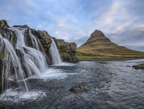landscape - cascade waterfalls flowing down a mountain river