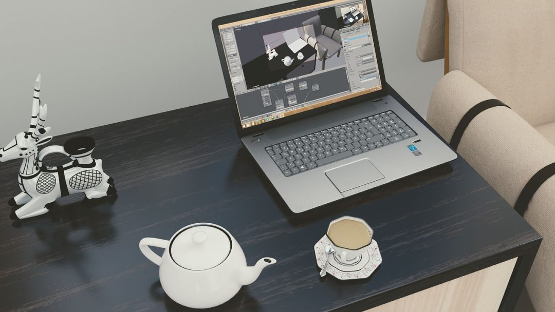 tea cup at laptop