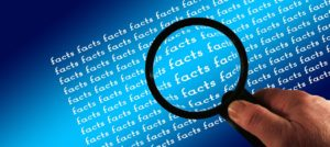Magnifier over an area with many repeats of the word Facts
