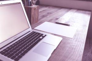 laptop, blank paper, pen
