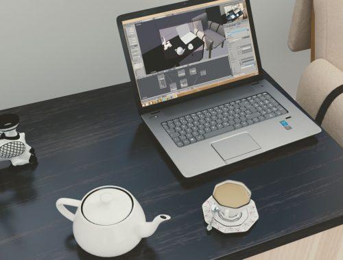 tea cup at laptop